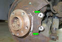 Then lightly grease the brake shoe to backing plate contact points (green arrows).