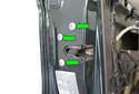 Remove the three T30 Torx door latch fasteners (green arrows).