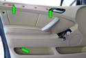 Remove the three remaining T20 Torx screws from the door trim (green arrows).