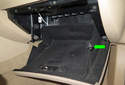 Next press in the right side of the glove box enough to clear the bumper (green arrow) on the right and allow the glove box to hang fully.