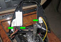 Unplug all the wiring harness (green arrows) from the shifter bezel and set it aside.