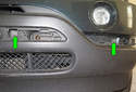 Using a 10mm socket, remove the two mounting bolts (green arrows) exposed after removal of the trim panels.