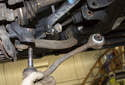 Lever the bushing out of the subframe using a pry bar.