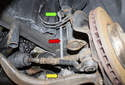 Front sway bar links: The front sway bar link (red arrow) connects the sway bar (yellow arrow) to the strut (green arrow).