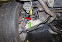 Rear sway bar links: The rear sway bar link (red arrow) connects the sway bar (yellow arrow) to the control arm (green arrow).