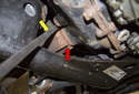 Next, use a long pry bar (yellow arrow) to lever the axle (red arrow) out of the front differential.