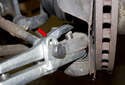 You will need a separating tool (red arrow) to remove the outer tie rod end from the steering knuckle.