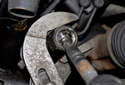 Next, loosen the inner tie rod end using a 32mm wrench or inner tie rod end tool.