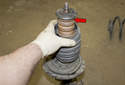 Once the nut has been removed, transfer the spring and parts over to the new strut.