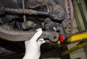Pull the tension strut down and away from the ball joint and let it hang out of the way.