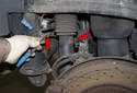 Rear sensor: Then remove the sensor wiring harness from the mounts (red arrows) and feed it out from behind the strut.