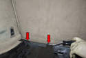 Then move toward the front of the trunk area, at the seat back and remove the plastic rivets (red arrows).