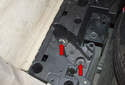 Next, you will have to remove the plastic nuts that secure the plastic bracket to the trunk floor.