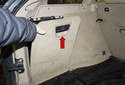 Then, open the storage compartment door and remove it (red arrow) from the vehicle.