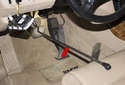 I like to use a brake pedal depressor (red arrow) to hold the brake pedal down.