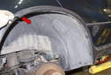 Rear liner: Pull the wheel well arch (red arrow) trim away from the fender enough to clear the wheel well liner.