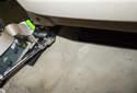 B-pillar trim: Next, remove the 16mm seat belt fastener (green arrow).
