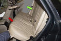 C-pillar trim: Start by removing the rear seat cushion (red arrow) and rear seat backrest side cushion (green arrow), on the side of the vehicle you are removing the C-pillar trim from.