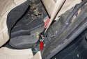 C-pillar trim: Next, remove the 16mm seat belt fastener (red arrow).