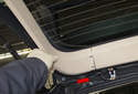 Once you detach the trim panels, slide them out (red arrow) of the top trim panel and remove them from the vehicle.
