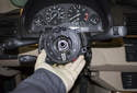Pull the switch assembly forward and remove it from the steering column and access the electrical connectors.