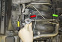 Next, you have to remove the secondary air solenoid and vacuum reservoir.