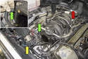 Move the wiring harnesses (yellow arrow) to the right side of the engine and place it out of the way.