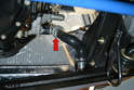 Working below the car use a Philips head screwdriver and remove the lower hose that connects the thermostat to the lower right radiator (red arrow).