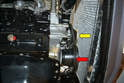 The belt travels around the crankshaft pulley on the bottom of the motor (red arrow), around the water pump (yellow arrow) and over the alternator.