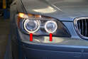 The Angle Eyes system on the E65 is the term referred to the lighting system that surrounds the two front headlights (red arrows).