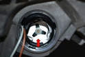 Inspect the port for any dirt, debris or damage before installing the new bulb/base.