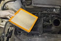 Pull the air filter out and replace it.
