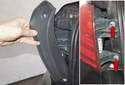 Unclip and lift the tail light trim up to remove.