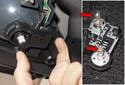 Squeeze the release tabs on the socket assembly and pull the socket assembly out of the tail light.
