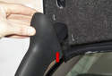 Then, unclip the trunk support trim cover (red arrow) from trunk carpet trim and remove from vehicle.