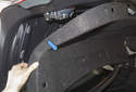 Remove the molded carpet trim from trunk lid (blue arrow).