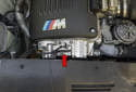 Variable camshaft timing (VANOS): VANOS (red arrow) is the BMW term for variable camshaft timing.