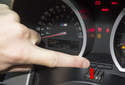 Turn off the ignition and place the vehicle in park or first gear (manual transmission).
