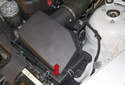 The air filter is located within the air filter housing (red arrow).