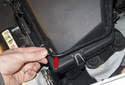 Start by removing the plastic line clipped to the intake air housing.