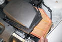 Once you release all the clips, lift the air filter-housing lid up and remove the air filter.