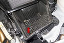 I suggest cleaning any debris (red arrow) from the air filter housing once the filter is removed.