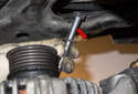 Then, wiggle the alternator as you pull the fastener out (red arrow) at an angle.