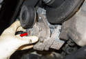 A/C belt tensioner: Remove the tensioner from the engine (red arrow).