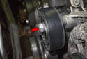 Accessory belt idler pulley: Remove the 16mm idler pulley fastener (red arrow).