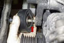 Accessory belt tensioner: Remove the pulley with the bolt.