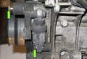Accessory belt tensioner: This photo shows both tensioner fasteners (green arrows) with the alternator removed for clarity.