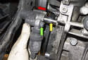 Accessory belt tensioner: Remove the tensioner (green arrow) from the engine by sliding it off the (red arrow) pivot pin (yellow arrow).