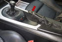 The parking brake handle (red arrow) and boot can dry rot and wear out over time, leaving a less than desirable interior appearance.