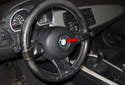 The steering column connects the steering wheel (red arrow) to the steering rack.